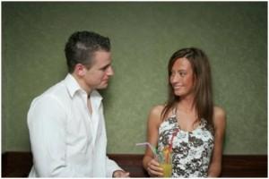 guy talking to woman at bar